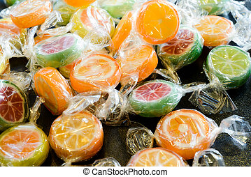 Ð¡andy lollipops - Scattered candy lollipops in a...