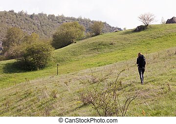 young woman hiking on River mountain trail