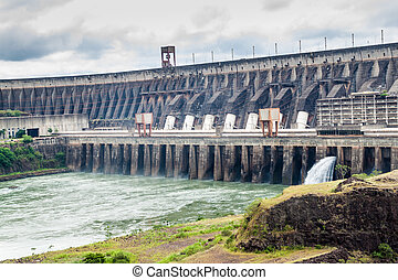Itaipu dam on river Parana on the border of Brazil and...