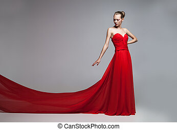 Model with flying skirt of red dress - Portrait of blonde...