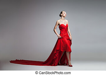 Young model in long red dress - Portrait of blonde model...