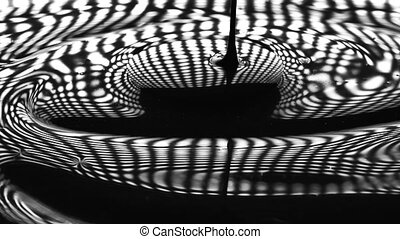 Dense liquid paint macro slow motion video. Black and white...