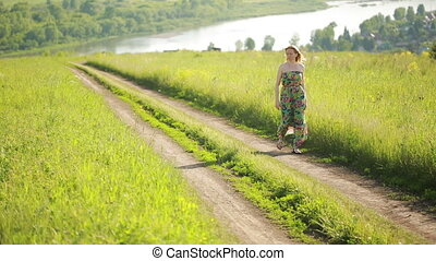 girl goes on a rural road.