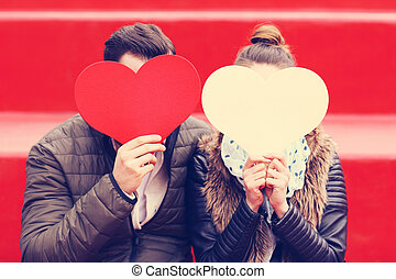 Romantic couple holding hearts - Picture of romantic couple...