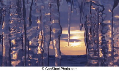 Setting sun is reflected in icicles Move the focus Beautiful...