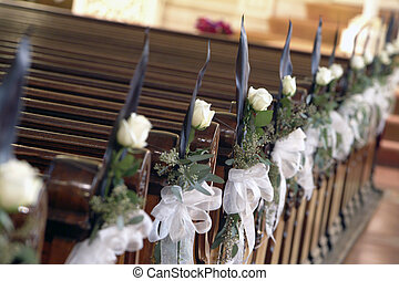 Church decoration - white rose decorated aisle
