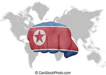 fist with the national flag of north korea on a world map...