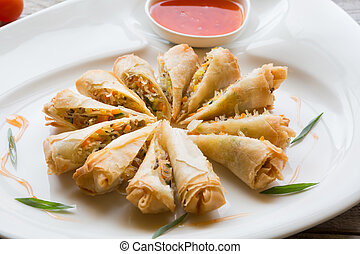 Vietnamese fried springroll served with chili sauce