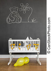 Create some art yourself - Shot of a cot in a baby room with...