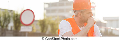 Blue collar worker - Tired blue collar worker with a...