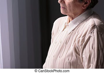Its not good being alone - Sad senior woman standing alone...