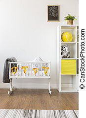 Decor for a happy baby - Cropped picture of a cozy white and...