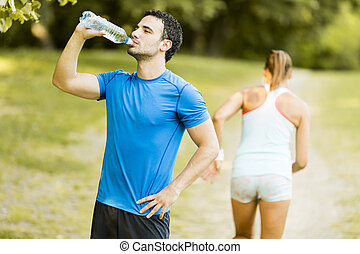 Young man drinking water from a bottle