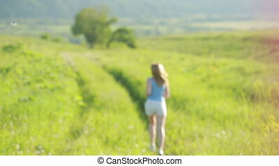 Running woman. Girl jogging on trail in mountains on field...