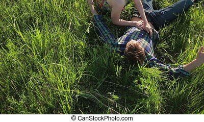 couple in love lying on the grass They embrace and kiss