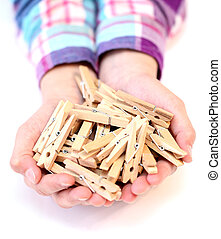 pegs in the hands of a child isolated on white background
