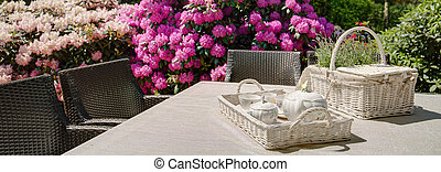 Teatime in the garden - close-up on table setting