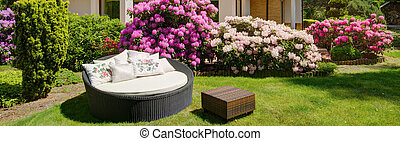 Round garden sofa to rest on sunny day