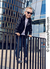 baby boy 7 - 8 years in sunglasses and black leather jacket...