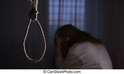 suicide. Girl on the background of the loop for the neck....