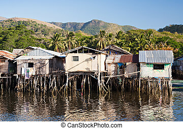 Slum houses staying on stilts in the sea