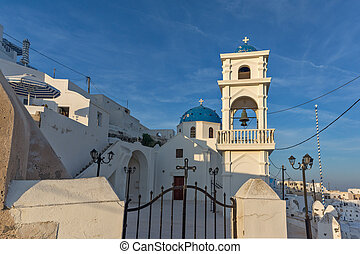 church in town of Imerovigli - Bell tower amd orthodox...