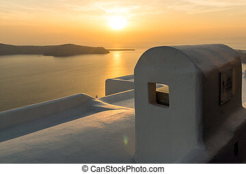 sunset in town of Imerovigli - White roof and Amazing sunset...