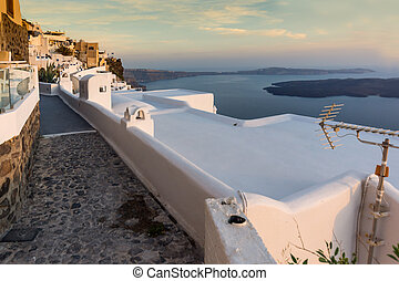 sunset in town of Imerovigli - Panoramic view of Santorini...