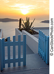 sunset in town of Imerovigli - Entrance of white house and...