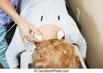 Electrical Stimulation Therapy - Chiropractic patient...
