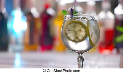 Glass of drink slowly rotates Beverage with slices of lemon...