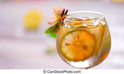 Drink decorated by small flower Glass of beverage turns...