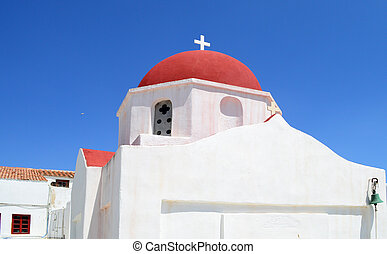 A white church with red roof on Mykonos island, Greece