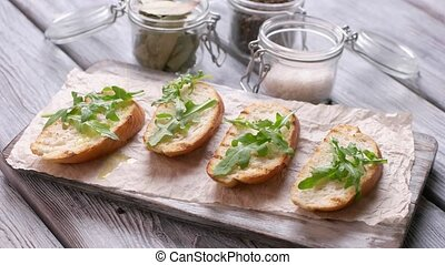 Slices of bread with herb Liquid pours on toasts Preparation...