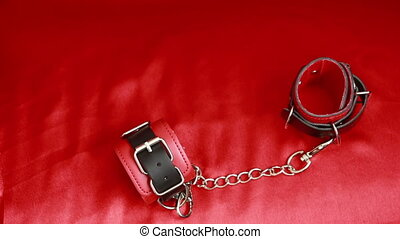 girl raises red handcuffs for sex games red leather...