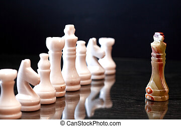 Chess Pieces Confrontation - Set of chess pieces made from...