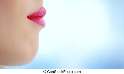 close up of young woman lips over blue color lipstick