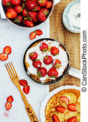 Strawberries and whipped cream for dessert. Pancakes with...