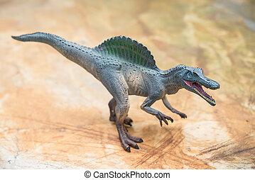gris, spinosaurus, juguete, posición, en, roca,
