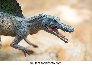 gris, spinosaurus, juguete, posición, en, roca,...