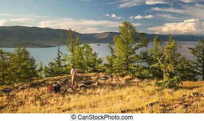 Hiker setting tent. Time lapse. - Tourist setting tent. Time...