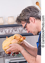 The chicken - First time a guy faces a raw chicken in the...