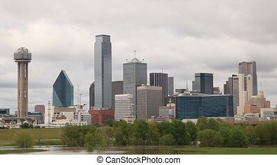 Dallas downtown skyline and Trinity river in the foreground....