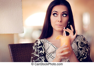 Surprised Woman With Orange Juice - Portrait of a beautiful...