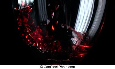 Filling wine glass with red wine super slow motion macro...