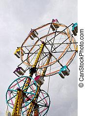 Ferris Wheel - A large ferris wheel or big wheel at a fair.