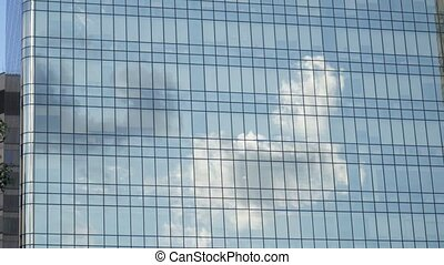 cloud reflection in modern office building, pan up, 4k UHD...