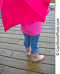Rain Gear - Little girl with boots, rain coat and umbrella...