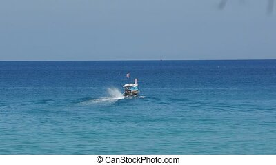 Longtail motor boat in ocean - Longtail motor boat out into...