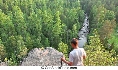 Hiker man standing on top of a mountain